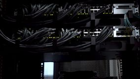 Ethernet network connection hub. Blinking lights in a dark server room, Close-up view of Ethernet cables wired to router stock footage