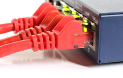 Ethernet network router switch with red cables. And green lights isolated on white background Royalty Free Stock Photo