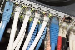 Ethernet Network Switch. With ethernet cables Royalty Free Stock Image