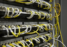 Ethernet patch panel. White and yellow cables Royalty Free Stock Photography