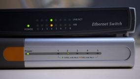 Ethernet router starts work and blink lights of connected data cables. Ethernet router starts work and blinks lights of connected data cables at office stock video footage