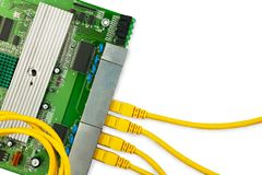 Ethernet switch board with 4 yellow patch cords and circle patchcord on the top. There are place for text in the right Stock Image