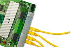 Ethernet switch board with yellow patch cords top view. There are place for text in the right Stock Photos