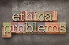 Ethical problems in wood type Royalty Free Stock Photo
