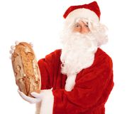 Ethical Santa - Bread Instead Of Gifts. An ethical santa reminding us that christmas is about sharing with the needy and not about buying useless junk Royalty Free Stock Photo