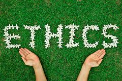 Ethics. Flowers arranged in ethics shape stock images