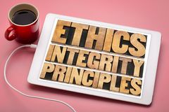 Ethics, integrity and principles concept on tablet. Ethics, integrity and principles word abstract - ethical concept on a digital tablet with a cup of coffee Stock Images