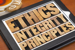 Ethics, integrity and principles. Word abstract - ethical concept on a digital tablet with a cup of tea Stock Photos