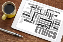 Ethics word cloud on tablet with coffee Royalty Free Stock Image