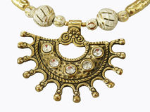 Ethinic Necklace. A background of an ethnic necklace with a huge golden pendent studded with diamonds Stock Photos