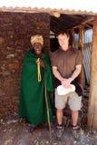 Ethiopia. Tourist with ethiopian blind priest at monasteries at lake tana in ethiopia royalty free stock photography