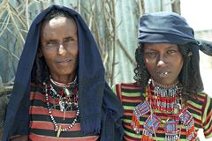 Group portrait Afar mother and daughter. Ethiopia, Afar region: Afar, an ethnic population of semi nomads, livestock farmers in Indoburi, is experiencing a royalty free stock photography