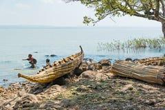 Ethiopia. Bahir Dar, Ethiopia - January 17 , 2016: Children playing in the Tana lake niar a reed canoe Royalty Free Stock Photography