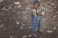 Ethiopia: Child feeling sad. One of the many children in the streets of Ethiopia. Sometimes life feels sad, sometimes they laugh their lungs out Stock Image