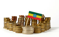 Ethiopia flag with stack of money coins Stock Photo