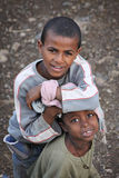 Ethiopia: Friends forever. Couple of many children in the streets of Ethiopia. Sometimes life feels sad, sometimes they laugh their lungs out Royalty Free Stock Images