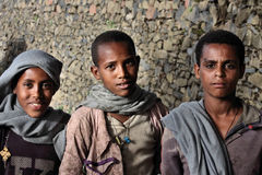 Ethiopia: Proud Ethiopian boys. Gang of friendly faces and enthusiast posers in Gonder, Ethiopia by the Royal Enclosure wall Stock Images