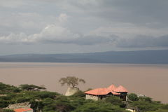 Ethiopia. River in Ethiopia and roofs Royalty Free Stock Photography