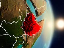 Ethiopia during sunrise. Highlighted in red on planet Earth with visible country borders. 3D illustration. Elements of this image furnished by NASA Stock Photo