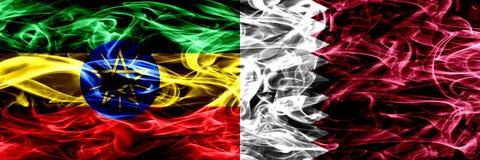 Ethiopia vs Qatar, Qatari colorful smoke flags placed side by side. Ethiopia vs Qatar, Qatari colorful smoke flags placed side by side stock photos
