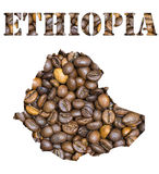 Ethiopia word and country map shaped with coffee beans background. Roasted brown coffee beans background with the shape of the word Ethiopia and the country Royalty Free Stock Photo