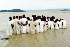 Ethiopian baptism. A group of people are receiving the christian baptism in the lake ziway in ethiopia stock images
