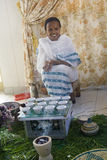Ethiopian coffee ceremony. A veiled woman prepares traditional Ethiopian coffee for guests Stock Photo
