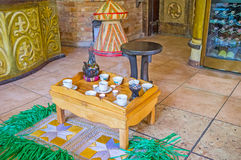 Ethiopian coffee ceremony. The tray with jebena coffee pot, finjal cups, candles and fragrant incense - the parts of traditional Ethiopian coffee ceremony in Royalty Free Stock Image