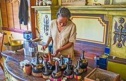 Ethiopian coffee making. KIEV, UKRAINE - JUNE 4, 2017: Traditional Ethiopian coffee ceremony is always performed by women -young Tigrayan girl brews coffee in Stock Photo