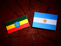 Ethiopian flag with Argentinian flag on a tree stump isolated Stock Photo