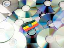 Ethiopian flag on top of CD and DVD pile isolated on white. Ethiopian flag on top of CD and DVD pile isolated Royalty Free Stock Photos