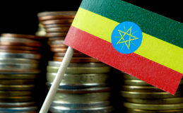 Ethiopian flag waving with stack of money coins Stock Image