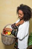 Ethiopian girl with fruit stock photography