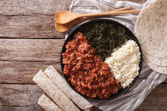 Ethiopian kitfo with herbs and cheese ayibe close-up. Horizontal Stock Photo