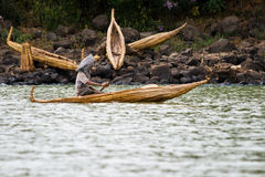 Ethiopian man transports goods in a papyrus boat. Stock Image