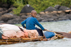 Ethiopian native transports goods on Lake Tana. Royalty Free Stock Photography