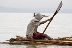 Ethiopian native transports logs on Lake Tana. Royalty Free Stock Photos