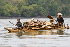Ethiopian natives transport logs on Lake Tana. Royalty Free Stock Image