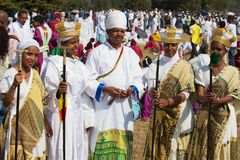Ethiopian people wearing traditional costumes take part in Timkat religious Orthodox festival in Addis Ababa, Ethiopia. stock image
