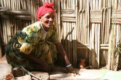 Ethiopian Woman. An Ethiopian woman from a tribe called the Dorze tribe preparing food Royalty Free Stock Image