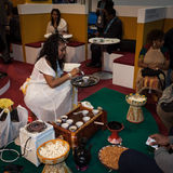 Ethiopian woman serving traditional coffee at Bit 2014, international tourism exchange in Milan, Italy Royalty Free Stock Images