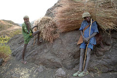Ethiopians with hay bundles Royalty Free Stock Images