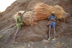 Ethiopians with hay bundles Royalty Free Stock Photo