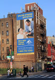Ethnic Advertising. The Williamsburg area of Brooklyn is an enclave of Hassidic Jews who dress in traditional clothing, and many of the outdoor advertisements Royalty Free Stock Photos