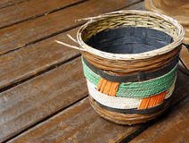 Ethnic african basket handicraft. An image of a cane woven basket of african tribal origin. In earthen colors of brown orange and green. Simple and beautiful stock image