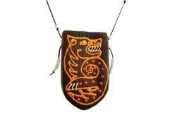 Ethnic amulet isolated on white. Ethnic wooden amulet isolated on white Royalty Free Stock Images