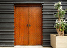 Modern architectural entrance wooden doors Royalty Free Stock Photography