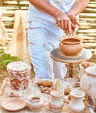 Ethnic art, skilled master creating pot of clay Stock Images