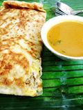 Ethnic asian Indian food Murtabak. An ethnics indian main course dish, mutton or lamb murtabak - with prata dough wraps containing a filling of chopped mutton Stock Images