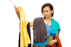 Ethnic asian young woman choose an outfit Stock Image